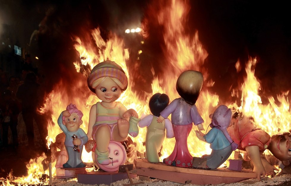 "Paper mache figures are burned during the Fallas festival in Valencia, Spain, Monday, March 19, 2012. Every year the city of Valencia celebrates the ancient ""Las Fallas"" fiesta, a noisy week that is full of fireworks and processions in honor of Saint Joseph which climaxes in the burning of large paper mache figures displayed around the streets of the city. (AP Photo/Alberto Saiz)"